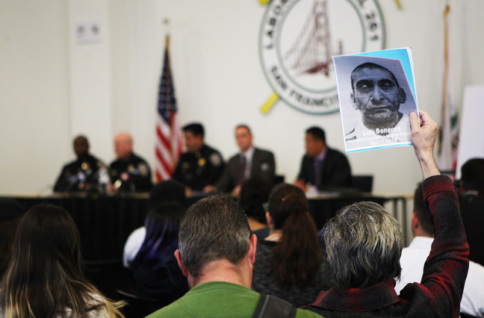 Frank Sosa, a member of the Anti Police-Terror Project, holds a sign with the portrait of Luis Gongora during a town hall meeting held at Laborers' Local 261 addressing the fatal shooting of Gongora by SFPD in San Francisco, California on April 13. Photo Joel Angel Juárez