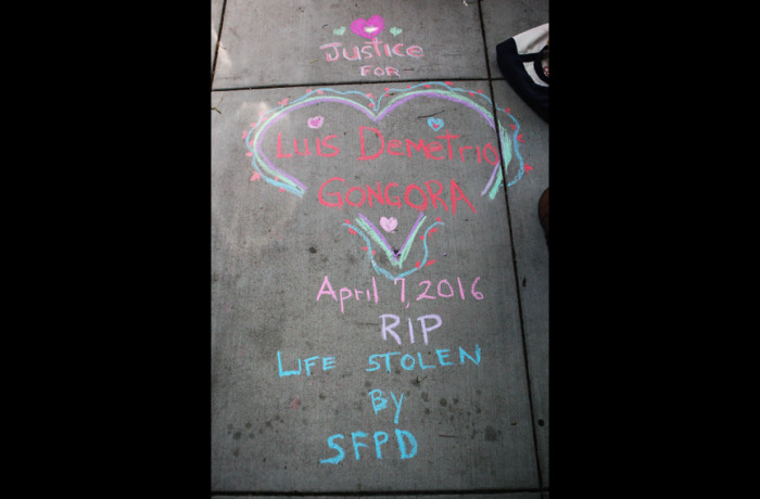 A chalk drawing by Adrienne Fong is seen on the sidewalk in front of a town hall meeting held at the Laborers' Local 261 addressing the fatal shooting of Luis Gongora by SFPD in San Francisco on April 13. Photo Joel Angel Juárez