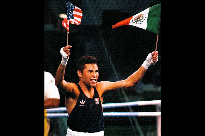 After winning the gold medal for Team USA at the 1992 Olympic Games in Barcelona, Spain, Oscar De La Hoya raises both American and Mexican flags, honoring his heritage. AP Photo/Mark Duncan