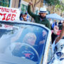 "The ""Frisco Five,"" a group of people on hunger strike outside the Mission Police Station, are cheered on by lowrider drivers and supporters, Sunday, May 1, 2016 in San Francisco, Calif. Maria Cristina Gutierrez, age 66, is seen at the wheel with her 42-year-old son Ilych Sato to her right. Edwin Lindo, age 29, is seen sitting on top of the car and to his left, Sellassie Blackwell, 39, and 42-year-old Ike Pinkston (to Lindo's right). Photo by Santiago Mejia."