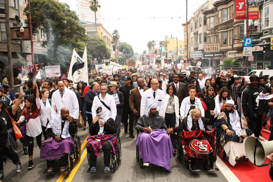 The Frisco 5 hunger strikers are pushed by wheelchair by doctors from UCSF during a march to City Hall demanding that Mayor Ed Lee fires SFPD Chief Greg Suhr on day 13 of their hunger strike on May 3, 2016 in San Francisco, California.