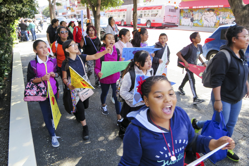 Students and families march from Buena Vista Horace Mann Elementary to John O'Connell High School as part of the Mission Graduates' March to College on Thursday May 12. The event hopes to encourage students in the Mission District to consider attending college. Photo Drago Rentería