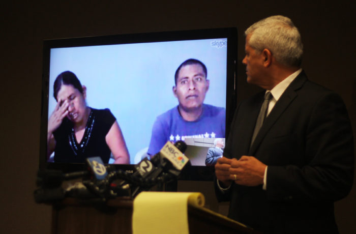 Margarita López weeps alongside her husband Juan Pérez during a Skype interview from Guatemala. Attorney Arnoldo Casillas (Right) is representing Amilcar Perez-Lopez's family in the Federal Civil Rights lawsuit that was filed against the SFPD on April 24, 2015. Photo Alexis Terrazas