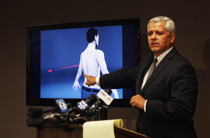 Attorney Arnoldo Casillas, who is representing Amilcar Pérez-López's family, points to an image that illustrates that his client was shot in the back by police while running away, during a press conference on April 24, 2015. Photo Alexis Terrazas