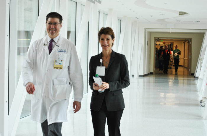 (From left) Dr. Todd May, and Dr. Susan Ehrlich, Zuckerberg San Francisco General Hospital and Trauma Center's chief executive officer, walk through the second-floor mezzanine skywalk bridge. Photo Alejandro Galicia Díaz