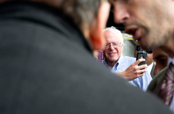 """Presidential hopeful Bernie Sanders walks down Mission Street greeting supporters and shop owners after giving a speech at City College of San Francisco's Mission Campus. Sanders started his walk on Mission Street between 24th and 25th and made it to 23rd Street before getting on a secret service vehicle. While walking through the 24th Street BART plaza, people cheered """"Se ve, se siente, Sanders for Presidente."""" Photo Mabel Jiménez"""