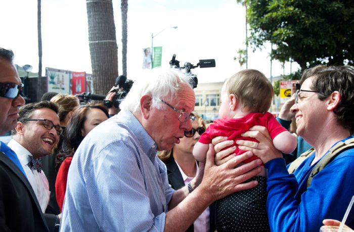 "Presidential hopeful Bernie Sanders walks down Mission Street greeting supporters and shop owners after giving a speech at City College of San Francisco's Mission Campus. Sanders started his walk on Mission Street between 24th and 25th and made it to 23rd Street before getting on a secret service vehicle. While walking through the 24th Street BART plaza, people cheered ""Se ve, se siente, Sanders for Presidente."" Photo Mabel Jiménez"