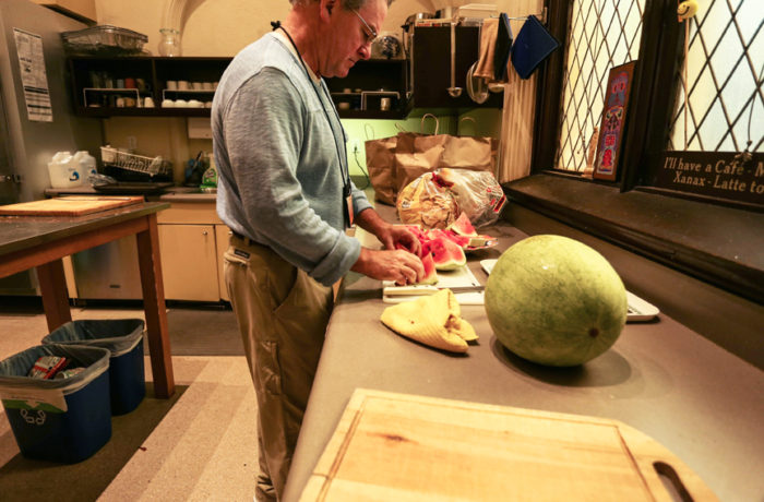 Jim Farrell, a Gubbio Project volunteer, prepares breakfast for homeless patrons. He has been volunteering with the organization for 2 months. Monday, June 27, 2016 Photo Jessica Webb