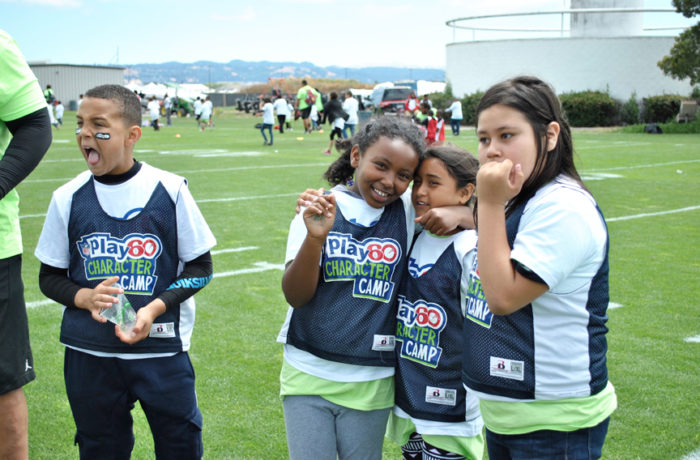 Children listen to instructions from their football coaches during the NFL Play 60 Character Camp in Alameda. Photo Alejandro Galicia Diaz