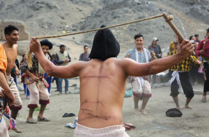 Piero Barrios, 16, shows his whip marks during the Pukllay Qarmenqas dance. Photo Manuel Orbegozo