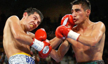 Erik Morales (right) battles his arch rival and fellow Mexican countryman Marco Antonio Barrera on June 22, 2002. Photo Laura Rauch/AP