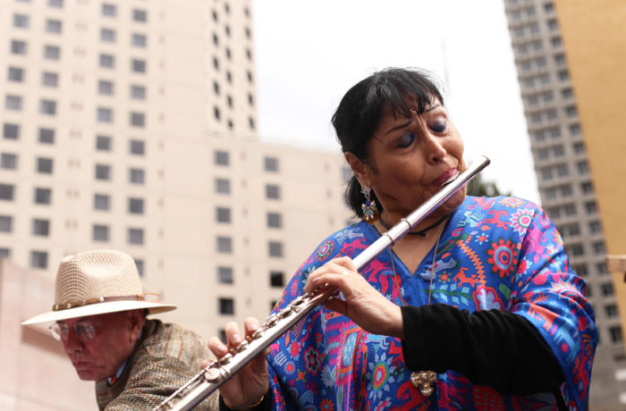 Oakland-born flautist Elena Durán serenading the crowd at the dedication ceremony for The Mexican Museum in San Francisco, California. Tuesday, July 19, 2016. Photo Jessica Webb