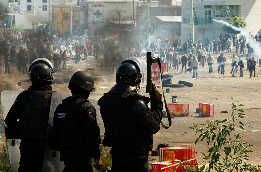Violent clashes between police and members of a teacher's union left at least six people dead and more than 100 injured in southern Mexico's Oaxaca state. The violence erupted as riot police moved in to dislodge protesters blocking a major road on June 19. Photo: Jorge Luis Plata/Reuters