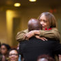 Gwen Woods hugs Minister James Calhoun on July 22 after his speech at the Mario Woods Remembrance Day ceremony at Cornerstone Missionary Baptist Church. Her son Mario was killed by SFPD officers in 2015. Photo Natasha Dangond