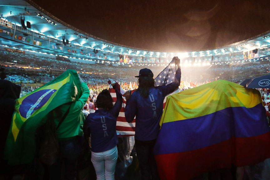 Spectators wave flags from Brazil, Colombia and the United States during the Olympics closing ceremony at Maracana stadium in Rio Janeiro on Sunday, Aug. 21. Courtesy CNN.com