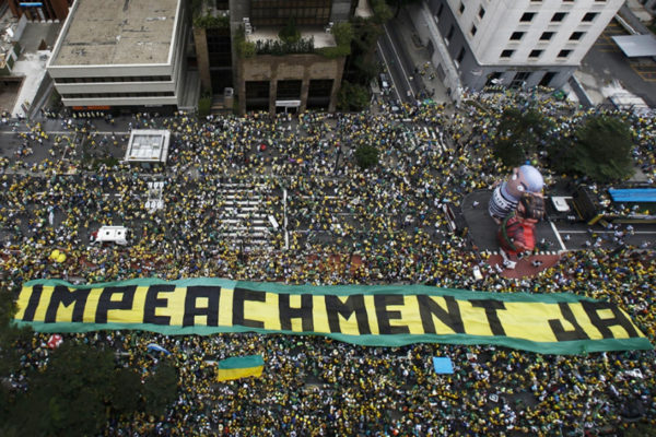 Huge crowds of demonstrators take part in a protest on Paulista Avenue in Sao Paulo, Brazil. Photo: Miguel Schincariol/AFP