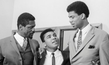 Lew Alcindor (right), who later changed his name to Kareem Abdul-Jabbar, alongside Bill Russell (left) and Cassius Clay (Muhammad Ali) in 1967. Bettmann Archive/GettyImages