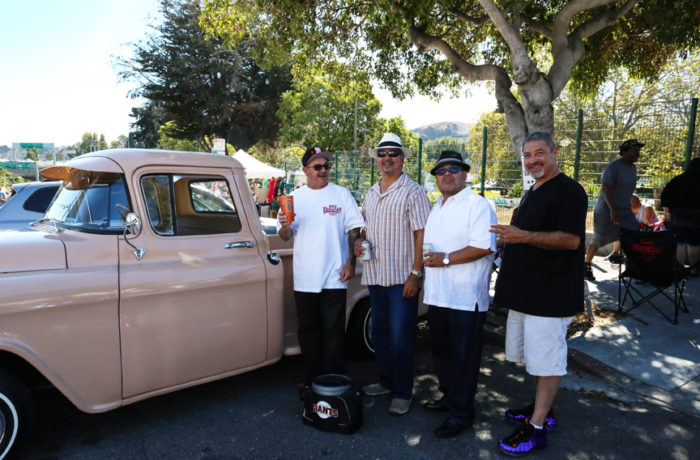 Miguel Gonzalez, Antonio Trejo, Ruben Tensos and Joe Doran enjoy beers and laughs at the the San Francisco Lowrider Council barbecue held at Potrero del Sol (La Raza) Park on Sunday, Sept. 18. Photo: Jessica Webb