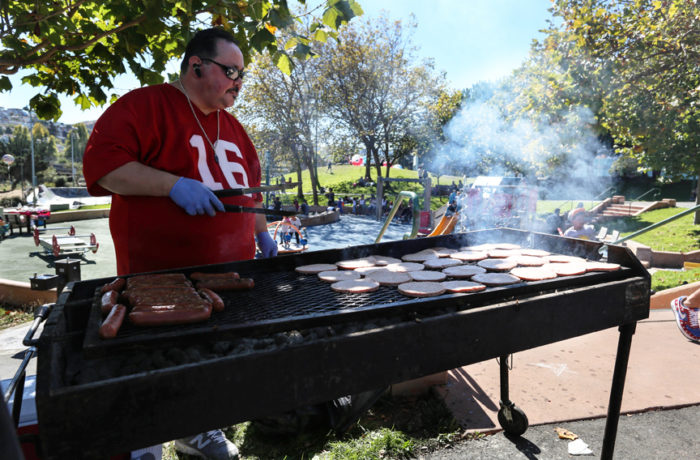David Garduno makes sure that no one goes hungry. The San Francisco Lowrider Council barbecue provided hot dogs and burgers for all. Sunday, Sept. 18, 2016. (Jessica Webb)