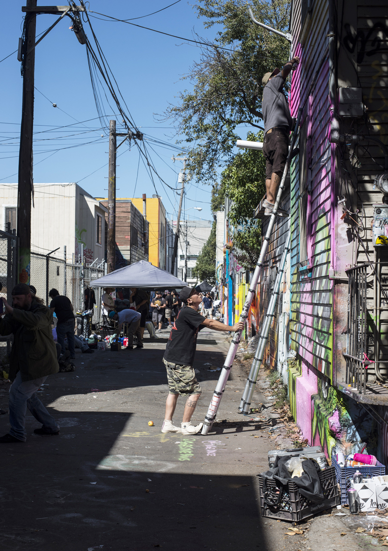 Artists from across the globe congregate in Lilac Alley for the Meeting of Styles 2015 street art event. Community murals were damaged during the event resulting in this year's festival being cancelled. Photo: Shane Menez