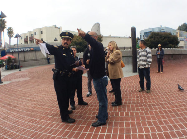 Mission Station Police Capt. Dan Perea reiterates to Meeting of Styles 2016 organizer Lisa Jo Brewer (brown jacket) that her event has been cancelled at the 24th Street BART Plaza on Sept. 16. Photo: Alexis Terrazas