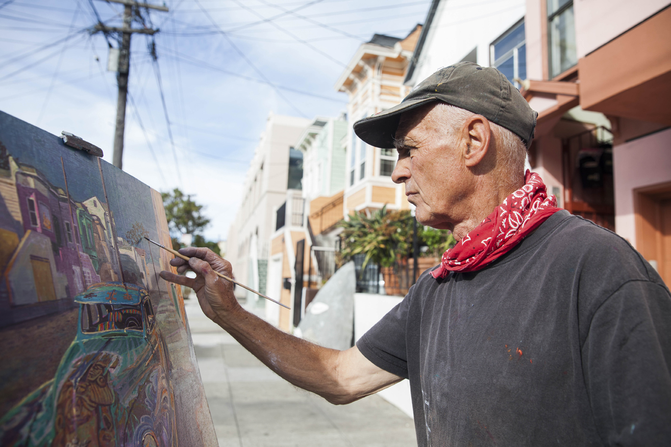 Anthony Holdsworth an urban landscape painter and local artist works on an oil painting of a lowrider with Florida Street scene on Florida Street near 26th Street in the Mission District, San Francisco on Thursday, Oct. 13, 2016. (Photo by Ekevara Kitpowsong)