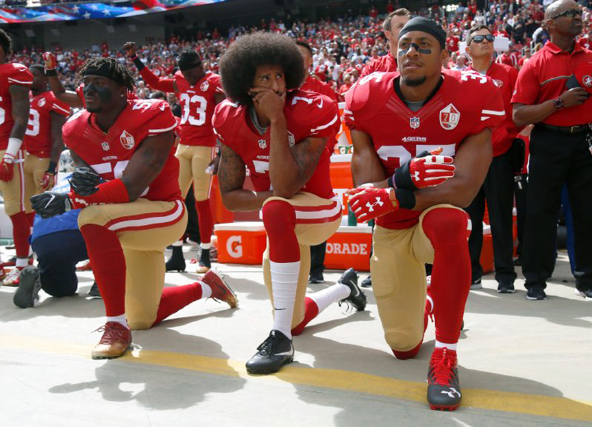 (From left) San Francisco 49ers Eli Harold (58), Colin Kaepernick (7) and Eric Reid (35) kneel during the national anthem on Oct. 2, before their game against the Dallas Cowboys at Levi's Stadium in Santa Clara. (Nhat V. Meyer/Bay Area News Group)