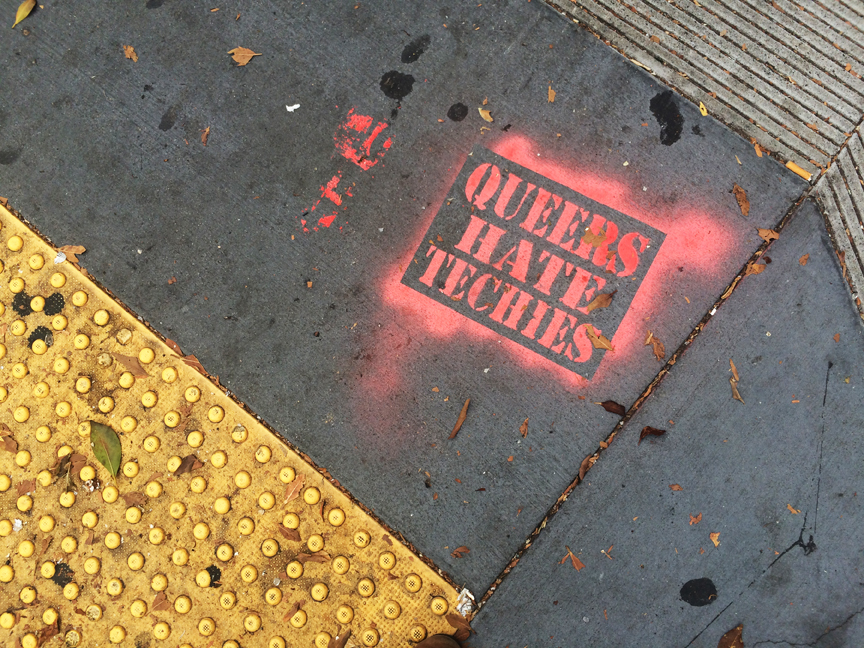 A stencil disparaging tech workers on a 24th Street sidewalk. Photo: Mabel Jiménez