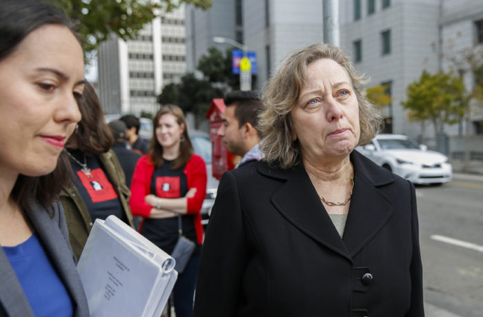 "San Francisco attorneys Natalie Orr (left) and Kristine Poplawski (right) speak during a press conference held by La Raza Centro Legal on Oct. 11 in front of the San Francisco Courthouse. The press conference was to draw attention to the fraud accusations against ""immigration specialist"" Leonard Lacayo. Photo: Emma Chiang"
