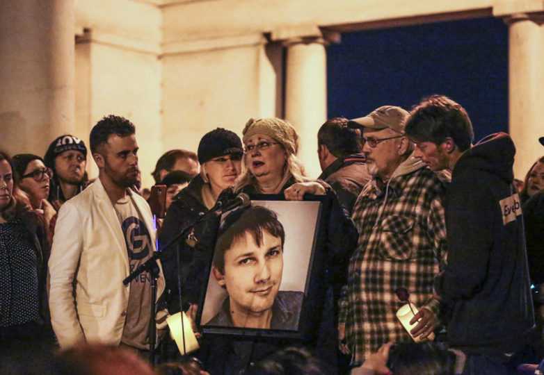 Parents of Travis Huff come forward during the vigil Monday night to honor and remember their son who was lost in the warehouse fire. Oakland, California, Monday, December 5, 2016. Photo: Jessica Webb