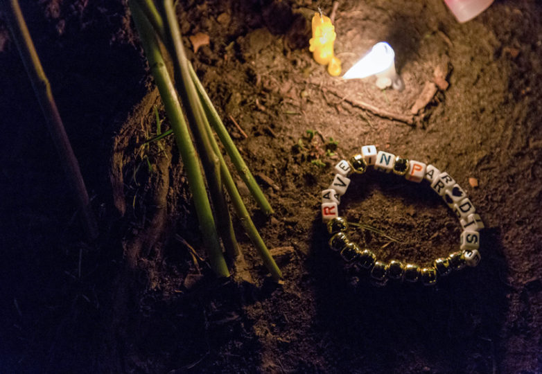 """A beaded bracelet reading """"Rave In Paradise"""" rests at the foot of a tree among an altar created during a vigil honoring the lives of the victims lost in a fire at Ghostship, a warehouse venue for artists in the Fruitvale District. Photo: Natasha Dangond"""