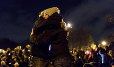 """Katie O'Bryant, left, and Amanda Floyd, right, hug one another during vigil honoring the lives of the victims lost in a fire at Ghostship, a warehouse venue for artists in the Fruitvale District. """"No one is not affected by this tragic event,"""" Floyd said said while looking at the people gathered around her. Photo: Natasha Dangond"""