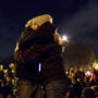 "Katie O'Bryant, left, and Amanda Floyd, right, hug one another during vigil honoring the lives of the victims lost in a fire at Ghostship, a warehouse venue for artists in the Fruitvale District. ""No one is not affected by this tragic event,"" Floyd said said while looking at the people gathered around her. Photo: Natasha Dangond"
