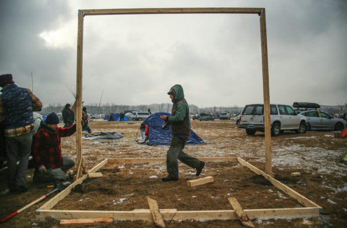 Water protectors set up permanent structures for the coming winter at the Oceti Sakowin Camp in the Standing Rock Indian Reservation, North Dakota on November 24, 2016. (Photo by Joel Angel Juárez)