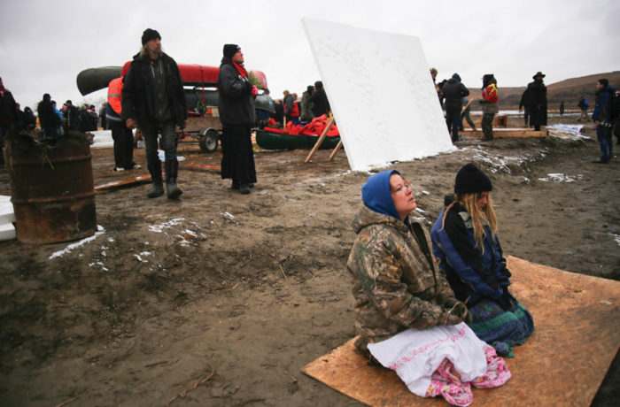Water protectors gather near the Missouri River as they pray defending a sacred site near Turtle Island against the Dakota Access Pipeline near at the Standing Rock Indian Reservation, North Dakota on November 24, 2016. (Photo by Joel Angel Juárez)