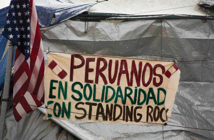 """A sign on Nov. 25 outside a camper's tent reads: """"Peruvians in Solidarity with Standing Rock,"""" at the main campsite, Oceti Sakowin Camp at the Standing Rock Indian Reservation. Photo: Natasha Dangond"""