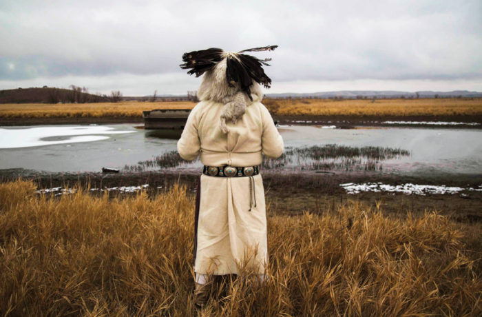 James Uqualla, a Native American elder from New Mexico looks out to the Cannonball River near Standing Rock Indian Reservation on Nov. 24. Photo: Natasha Dangond