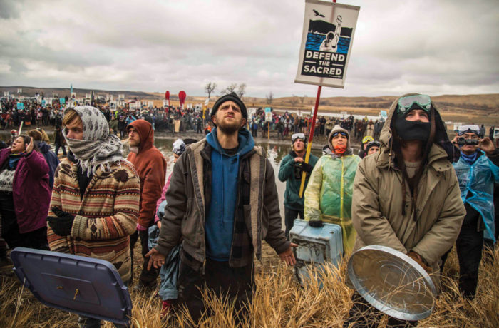 Water protectors gather in a large prayer circle at the foot of the Cannonball River on Thanksgiving (Nov. 24) for a direct action against the Dakota Access Pipeline. Photo: Natasha Dangond