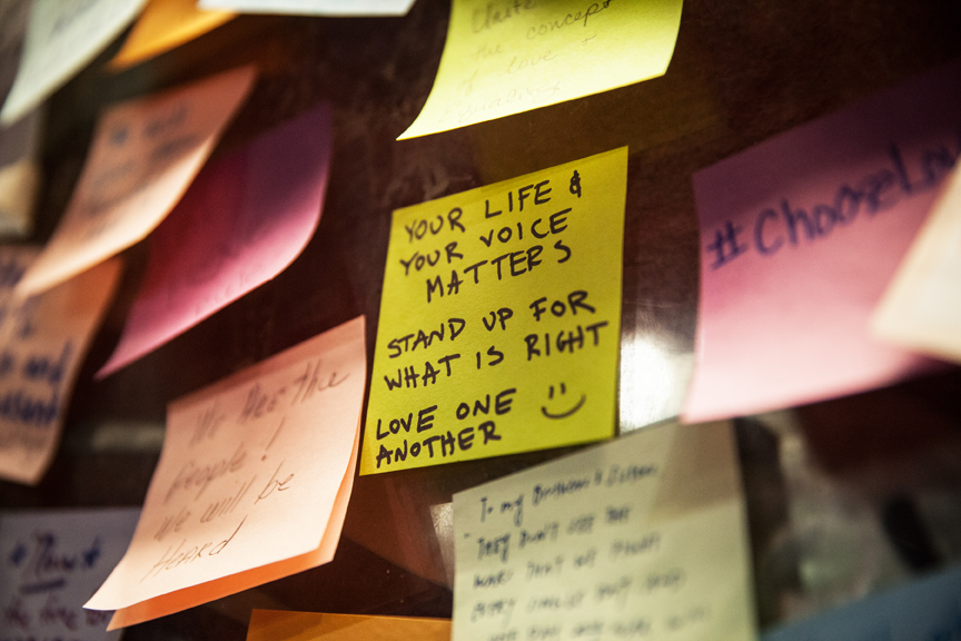 """Sticky notes, a reaction to Donald Trump's election, cover the """"Wall of Empathy"""" on  Nov. 14, 2016 at 16th Street BART station. Photo: Ekevara Kitpowsong"""