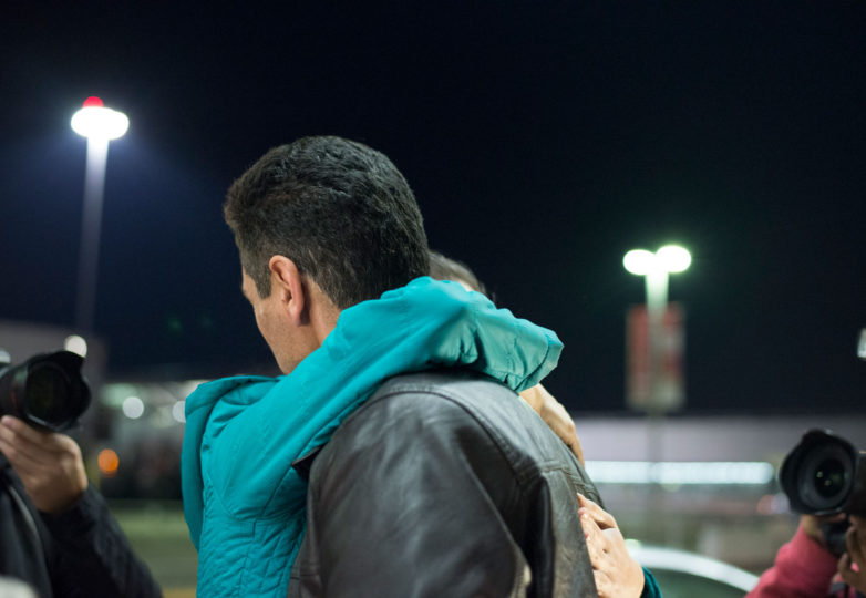 Nilofar Radgoudari hugs her father Menti Radgoudari just as he was released from being detained at San Francisco International Airport (SFO) for five hours on Saturday, January 28. Menti Radgoudari is a green card holder from Iran. Photo: Desiree Rios