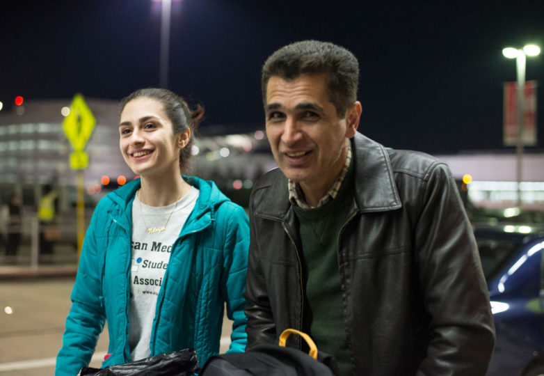 Nilofar Radgoudari (Left) and her father, Menti Radgoudari (Right) make their way home after Menti was detained at San Francisco International Airport (SFO) for five hours on Saturday, January 28. Photo: Desiree Rios