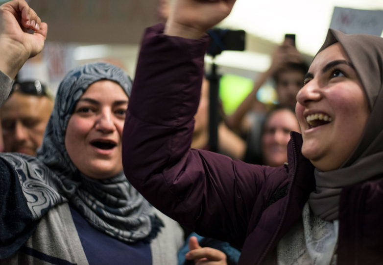 Syrian-American, Bayan Tahan (Right) rejoices with her mother during a protest against President Trump's executive order that bars citizens of seven Muslim-majority countries from entering the United States for the next 90 days and suspends the admission of refugees for 120 days at San Francisco International Airport (SFO) on Saturday, January 28. Photo: Desiree Rios