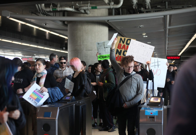 Protesters file through BART station at the SFO International Airport to join other protesters  in the arriving terminals in San Francisco, Calif. on January 28, 2017. Photo: Janett Perez