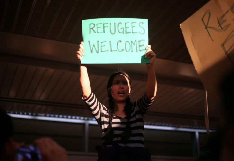 Nicole Wong, 38, San Francisco resident protests at the arriving terminals of the SFO  International Airport in San Francisco, Calif. on January 28, 2017. Photo: Janett Perez
