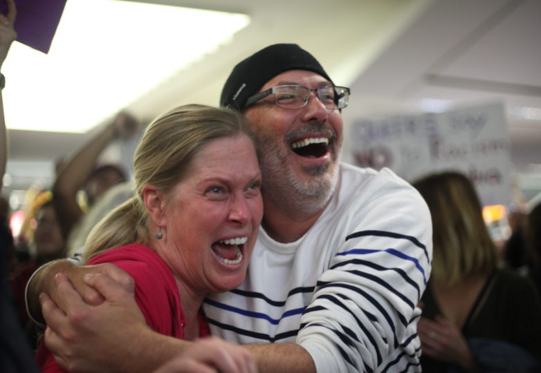 A couple rejoices at the news of a detainee being released from the JFK airport in New York  while during the protest at the SFO International Airport in San Francisco, Calif. on January 28, 2017. Photo: Janett Perez