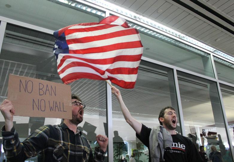 Daniel Kelly (left), 30, Oakland resident and Joseph Kellner (right), 29, Oakland resident  protest the SFO International Airport in San Francisco, Calif. on January 28, 2017. Photo: Janett Perez