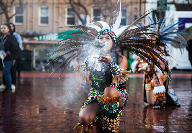 Aztec dancers brave heavy rain to perform in front of crowd of protestors at Anti-Trump rally on inauguration day, Friday, Jan. 20, 2017 at United Nations Plaza in San Francisco, Calif. (Photo by Ekevara Kitpowsong)