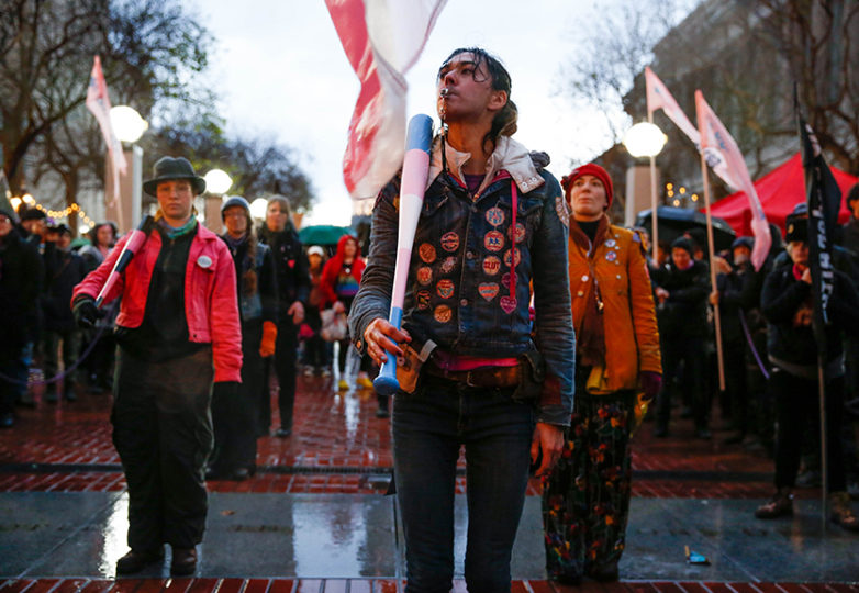 Members from The Degenderettees a gender queer feminist art club perform a color guard at the United Nations Plaza across San Francisco City Hall during a protest against United States President Donald Trump in San Francisco, Calif. on inauguration day January 20, 2017. Photo: Emma Marie Chiang