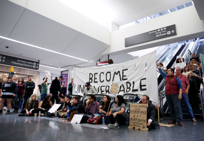 Over one thousand protesters occupy the international terminal at San Francisco International Airport in San Francisco, Calif. Sunday, January 29, 2017. Photo by Emma Marie Chiang