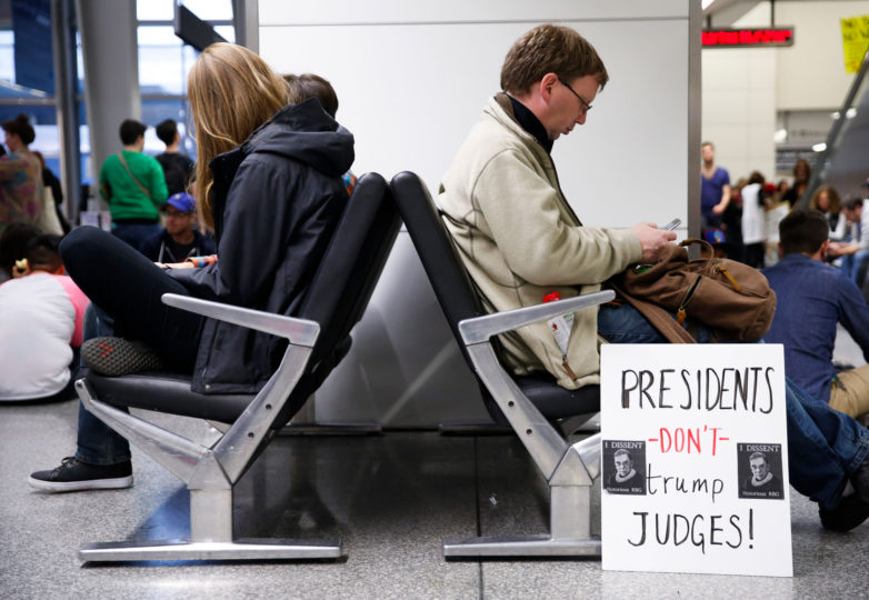 People sit in chair during a protest at the international terminal of San Francisco International Airport in San Francisco, Calif. Sunday, January 29, 2017 to draw attention to President Donald Trump latest executive order to deny citizens of seven Muslim-majority countries from entering the United States. Photo by Emma Marie Chiang